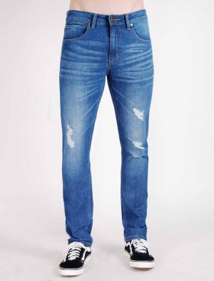 Rifle Distressed Low Rise Skinny Tapered Jeans in Medium Wash